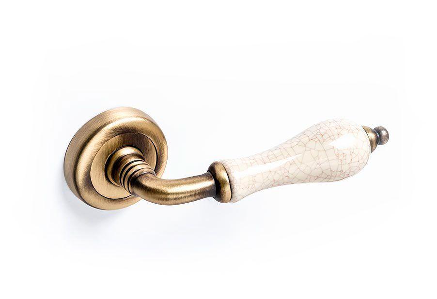 Manivela tirador con porcelana para puerta Málaga